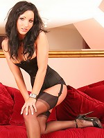 Sexy brunette Bunny in black corset and nylons